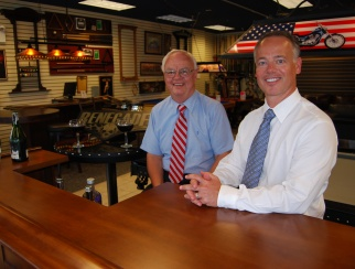 Bob Jones III (right) with father Robert Jones, Sr. (left). Take a closer look at an American Sale store.