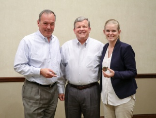 Tom Shull (center) brought 'The Exchange' badges for co-hosts Bill Thorne (left) and Sarah Rand (right).
