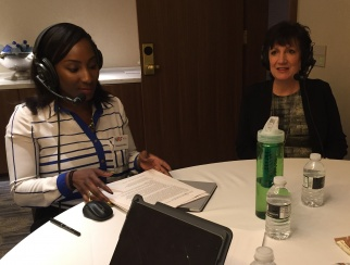 Anne Voller (right) records a podcast episode with host Shaquayla Mims (left).