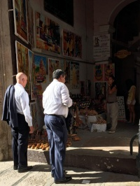 NRF CEO Matthew Shay (left) and former NRF Chairman Steve Sadove visit a market space in Old Havana.
