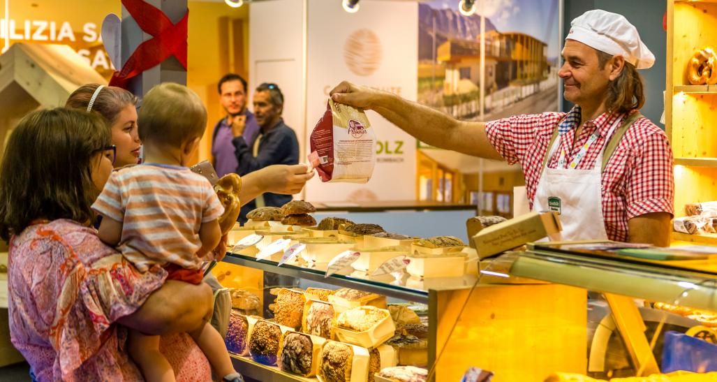 Customers buying bread at small business bakery in Europe