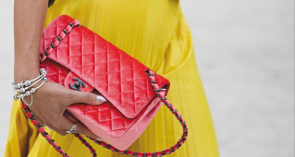 Luxury fashion bag in girl's hand