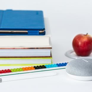 A stack of books and an apple