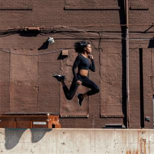 Woman jumping in the air wearing S3 Active