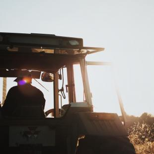 farm worker driving heavy equipment