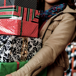 holiday shopper carrying giftwrapped items