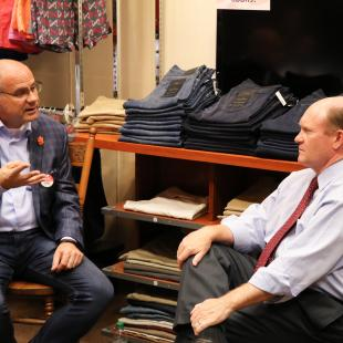 Store owner Trey Kraus speaking with Sen. Coons of Delaware during NRF Store Tour