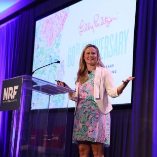 Lilly Pulitzer CEO Michelle Kelly speaking on stage at NRF NXT