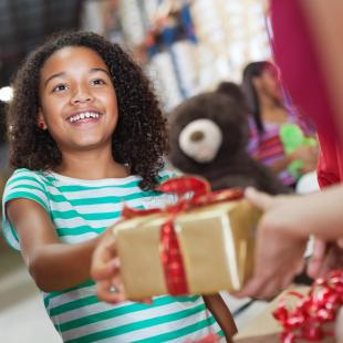 Child donates gift at gift drive