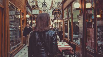 Unsplash woman walking through shopping experience