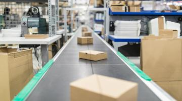 boxes are shown on a conveyor belt