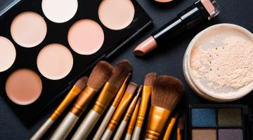 Makeup brushes, lipstick and powders