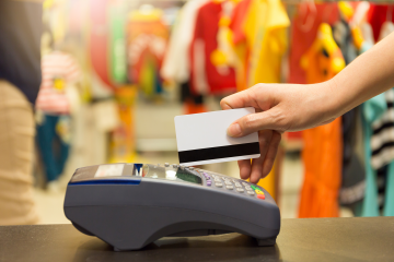 credit card swipe at a retailer
