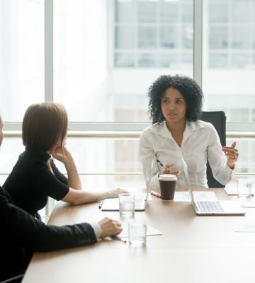 Woman leading meeting