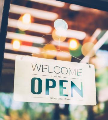 Photo of open sign on shop door