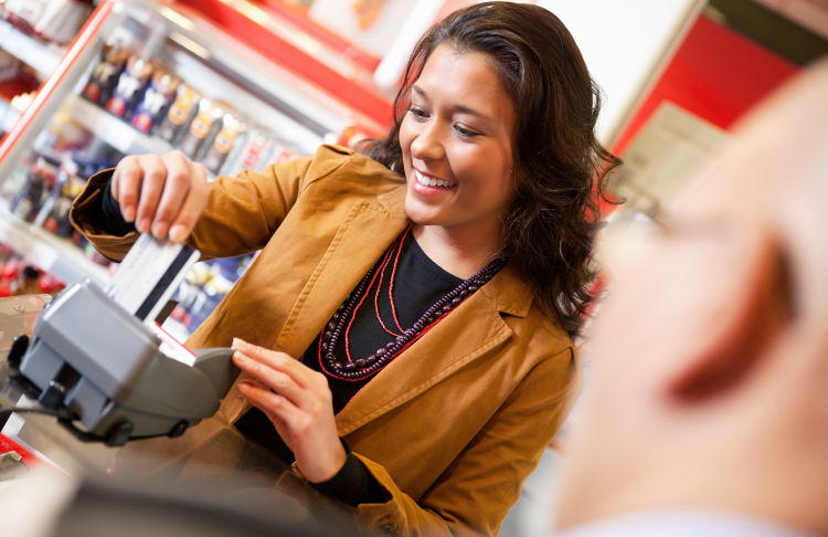 inserting a chip card to pay for groceries