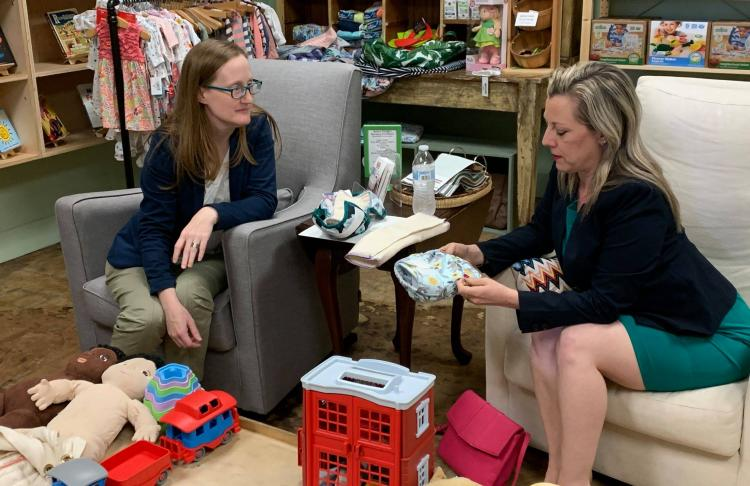 Rep. Kendra Harris examines merchandise at The Green Bambino