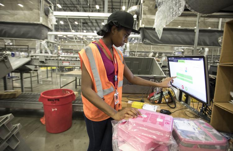 Employee at Williams Sonoma warehouse working on computer