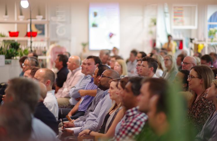 Audience at an event listening to speaker