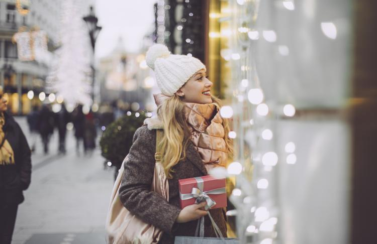 Woman window shops during holidays