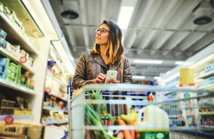 A woman shops in grocery store